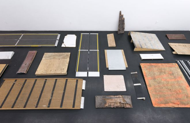 image of Park McArthur's installation titled Ramps. Depicted here are an assortment of makeshift ramps that McArthur collected from NYC store fronts.